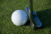 Golf Ball Framed Prints - Close View Of A Putter Against A Golf Framed Print by Todd Gipstein