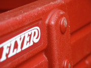 Wagon Photos - Closeup of a Bright Red Wagon by Mark Delfs