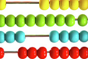 Mathematics Prints - Closeup of bright  abacus beads on white Print by Sandra Cunningham