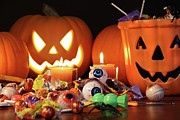 Junk Photos - Closeup of candies with pumpkins  by Sandra Cunningham