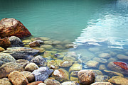 August Prints - Closeup of rocks in water at lake Louise Print by Sandra Cunningham