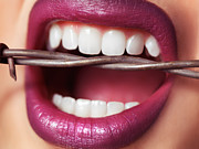 Make-up Posters - Closeup of Womans Mouth Biting on Barbed Wire Poster by Oleksiy Maksymenko
