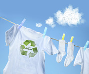 White Posters - Clothes drying on clothesline with go green sign  Poster by Sandra Cunningham