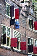Building. Home Posters - Clothes hanging from a window in Kattengat Poster by Fabrizio Troiani
