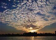 Riversides Prints - Clouds And Sky At Sunset Over The Nile Print by Axiom Photographic
