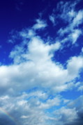Sami Sarkis Prints - Clouds in a beautiful blue sky Print by Sami Sarkis