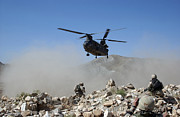 Afghanistan Photo Posters - Clouds Of Dust Kicked Up By The Rotor Poster by Stocktrek Images