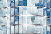 Architectural Detail Framed Prints - Clouds Reflecting Off an Office Building Framed Print by John Harper