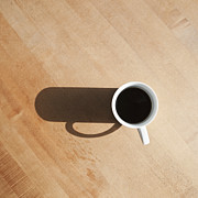 Coffee Mug Prints - Coffee Cup and Shadow on a Table Print by Jetta Productions, Inc