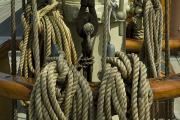 Wooden Ships Framed Prints - Coiled Ropes Hanging On An Old Wooden Framed Print by Todd Gipstein