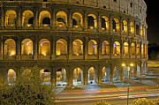 Illuminated Framed Prints - Coliseum  illuminated at night. Rome Framed Print by Bernard Jaubert