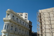 Neo-classical Posters - Colonial architecture next to a new building still under construction in Havana Poster by Sami Sarkis