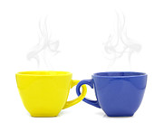 Yellow Ceramics Posters - Color cup with hot drink on white background Poster by Natthawut Punyosaeng