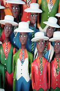 Wooden Sculptures Prints - Colorful African Carved Figures 1 Print by Neil Overy