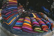 Bedding Prints - Colorful Blankets Fill A Street-side Print by Heather Perry