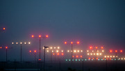 Runway Prints - Colorful Fogbound Landing Lights Guide Airplanes Print by John K. Goodman