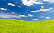 Mongkol Chakritthakool Metal Prints - Colorful Hot Air Balloon Against Blue Sky Metal Print by Mongkol Chakritthakool