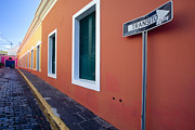 Cobblestone Street Prints - Colorful Narrow Street with a Sign Print by George Oze