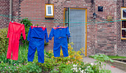 Laundered Posters - Colorful overalls on the clothesline of a farm Poster by Ruud Morijn