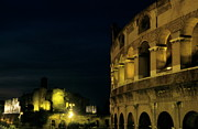World Cities Posters - Colosseum illuminated at night and the forums Poster by Sami Sarkis