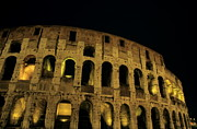 Old Ruins Framed Prints - Colosseum illuminated at night Framed Print by Sami Sarkis