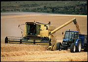 Combine Framed Prints - Combine Harvester Off-loading Grain Framed Print by Jeremy Walker