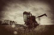 Machinery Photo Framed Prints - Combine out to Pasture Framed Print by Thomas Zimmerman