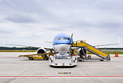 Commercial Airplane Framed Prints - Commercial Airliner Parked At An Framed Print by Corepics