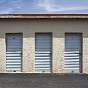 Black Top Photo Acrylic Prints - Commercial Storage Facility Acrylic Print by Paul Edmondson