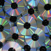 Disc Photos - Compact Discs With Light Interference Patterns by Damien Lovegrove