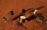 Buried Photos - Computer chips on red sand by Sami Sarkis