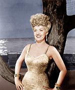 Gold Lame Prints - Coney Island, Betty Grable, 1943 Print by Everett