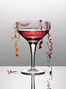 Champagne Framed Prints - Confetti Hanging From Glass Of Pink Champagne With Lipstick Stain Framed Print by Andy Roberts