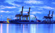 Port Town Framed Prints - Container Cargo freight ship with working crane bridge in shipya Framed Print by Anek Suwannaphoom