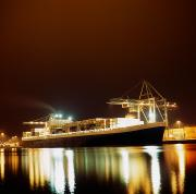 Water Vessels Prints - Container Ship Ship Illuminated At Night Print by The Irish Image Collection