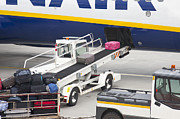 Air Travel Prints - Conveyor Unloading Luggage Print by Jaak Nilson