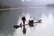 Autonomous Prints - Cormorant Fisherman On A Bamboo Raft Print by Raymond Gehman