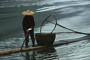 Fishing Boats Framed Prints - Cormorant Fisherman On Bamboo Raft, Li Framed Print by Raymond Gehman