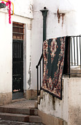 Old Rug Framed Prints - Corner Door in Lisbon Framed Print by John Rizzuto