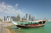Doha Photo Framed Prints - Corniche dhow and skyline Framed Print by Paul Cowan
