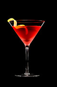 Garnish Photos - Cosmopolitan cocktail in front of a black background  by Ulrich Schade