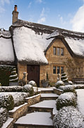 House With Garden Framed Prints - Cotswolds cottage covered in snow Framed Print by Andrew  Michael