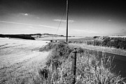 Lowlands Prints - country road through scottish lowlands farmland lothian Scotland Print by Joe Fox