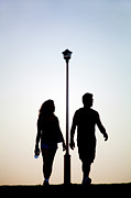 Mid Adult Women Metal Prints - Couple Exercise While Walking At Sunset Metal Print by Virginia Star