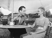 Slicked Back Hair Posters - Couple Having Ice Tea Outdoors, (b&w) Poster by George Marks
