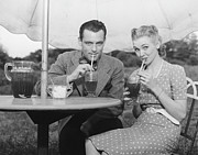 Slicked Back Hair Posters - Couple Having Ice Tea Outdoors, (b&w), Portrait Poster by George Marks