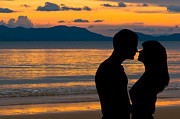 Sweet Kiss Prints - Couple in love at sunset Print by Ulrich Schade