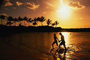 Heterosexual Couple Framed Prints - Couple On Beach At Sunset Framed Print by Linda Ching