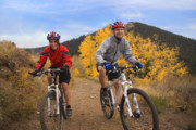 Bicyclists Prints - Couple on Mountain Bikes Print by Utah Images