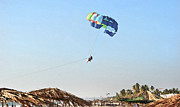 Drifter Framed Prints - Couple parasailing over shacks Goa Framed Print by Kantilal Patel